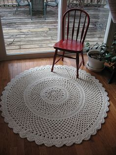 Another doily throw rug, this one crocheted with 3 strands of worsted weight yarn and a 10 mm (N/P) hook). Pattern in Leisure Arts #102640 Crochet Collection. Ooh, I have the yarn for this!