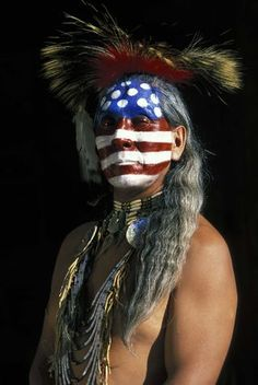 Native American Warrior with face paint of American flag.