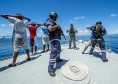 VICTORIA,Seychelles(Nov.14,2013)Petty Officer 2nd Class John A.Wilcox,US Navy maritime interdiction operations expert, instructs boarding team members from Mauritius on detainee procedures during underway phase of Cutlass Express 2013.Multinational maritime exercise off East Africa to improve cooperation,tactical expertise & information sharing among East African maritime forces in order to increase maritime safety & security in the region.(USN Mass Comm Spec Seaman Luis R.Chavez Jr.)