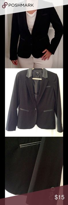 Blazer with leather lapels and leather pockets. This slim fit black blazer has faux leather lapels and faux leather trim on the pockets. This jacket is a size 10. Very flattering cut when buttoned. Apt. 9 Jackets & Coats Blazers