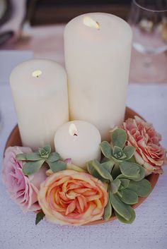 Spanish-Mexican Wedding Inspiration: Centerpieces with pillar candles, succulents and flowers.