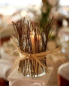 Fall Weddings  you could do this with mason jars and tealights inside. I already have the mason jars and twigs are free so this would be super cheap! you could even spraypaint the twigs gold, white, or even red!
