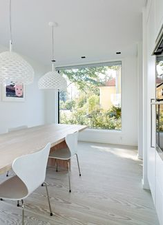 Untreated spruce wood used for the staircase and flooring throughout the interior of this home is complemented by raw concrete and plasterboard to create a calm, muted environment.