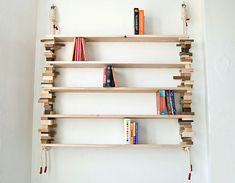 Bookshelf from waste wood blocks and rope