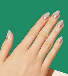Manicure-wise, there's nothing more feminine than the traditional French tip. Change it up while keeping the same elegance by creating a reverse French tip design using contrasting colors. See this manicure on Paintbox Nails »  - GoodHousekeeping.com