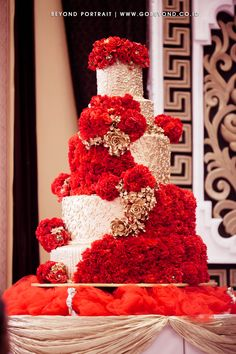 Grandeur red and white ruffled wedding cake | Project by Beyond Portrait http://www.bridestory.com/beyond-portrait/projects/roy-yanti