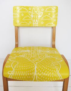 The animals are celebrating on this stunning upcycled school chair. This piece has been restored and painted a gorgeous vibrant yellow. The
