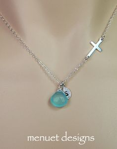 Matching necklaces for bride and bridesmaids - mine had a pearl and bridesmaids had emeralds