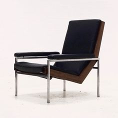 Located using retrostart.com > Lotus Lounge Chair by Rob Parry for Gelderland