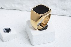 """This dignified signet ring takes its name from the Finnish word for """"rich."""" It's a fitting title for a piece that is adorned with black onyx — a gemstone that has been popular in jewelry making since"""