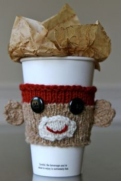 Free pattern at http://www.ravelry.com/patterns/library/george---sock-monkey-cup-cozy#