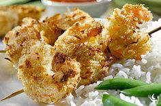 Coconut Shrimp With Sweet & Sour Sauce And Jasmine Rice - A bounty of large shrimp coated with a sweet coconut crust bakes up in only 15 minutes. Watch them disappear from the dinner table like stolen treasure. Serve with our kicked-up sweet & sour sauce for a quick and easy dinner or serve as an appetizer at your next party.
