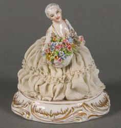 Dresden lace figurine. Using real lace dipped in liquid porcelain and then attached to porcelain ball gowns...