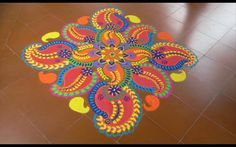 Get of beautiful rangoli designs for Diwali, New Year and Competition. Discover these beautiful rangoli designs of Ganesh, peacocks and with flowers. Indian Rangoli Designs, Rangoli Designs Latest, Latest Rangoli, Rangoli Designs Flower, Colorful Rangoli Designs, Flower Rangoli, Beautiful Rangoli Designs, Rangoli Colours, Rangoli Patterns