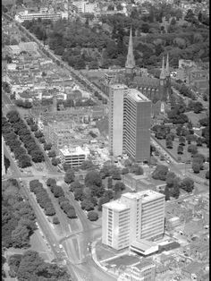 """East Melbourne with the newly constructed """"Green Latrine' former Commonwealth Building, demolished circa 1988 in foreground and Melbourne's first true skyscraper, the ICI Building (built protected) at rear Melbourne Map, Melbourne Suburbs, Melbourne Victoria, Victoria Australia, Melbourne Australia, Australia Travel, Terra Australis, Melbourne Architecture, Aerial Images"""