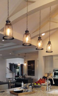 Hanging lights in the kitchen are the in thing and can be swapped out easily as styles change.  They provide excellent light for the kitchen and surrounding areas.