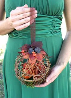 cage flowers/ bouquet alternative - grapevine ball could be filled with moss, flowers etc