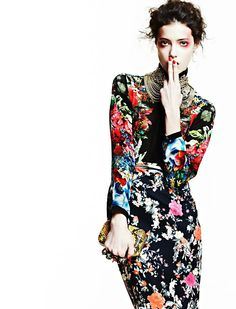 Intense florals on black background with heaps of jewelry