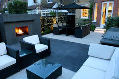 JMK says:- I love this contemporary garden with it's built in fireplace for evenings. - Click to see loads of more interesting designs from this company.