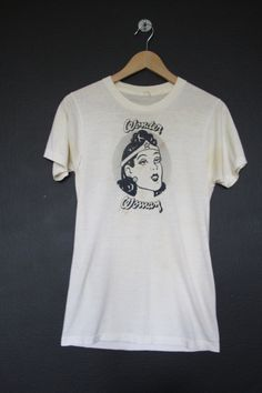 Wonder Woman vintage Tshirt. Size Women's Medium. Measurements: Back of collar to bottom hem: 16 Pit to pit: 26.5 This shirt is in great vintage condition with some minor marking. We do our best to describe all items. All shirts are sold in As-Is condition. Please keep in mind that this is
