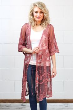 Mesh kimono jacket with lace details throughout. We love the scalloped edge sleeves and the sheer look of the mesh. Perfect over a dress, with jeans, or even shorts!