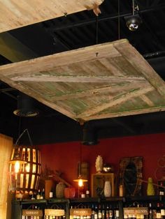 barn door used as a drop ceiling..... LOVE