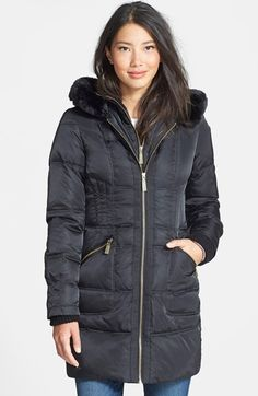 Free shipping and returns on Vince Camuto Faux Fur Trim Hooded Quilted Walking Coat at Nordstrom.com. A chunky knit collar tops the inner vest front of a hooded coat warmed with down-and-feather fill. Silky faux fur adds elegance at the hood, while a contemporary quilt pattern accentuates curve-flattering lines.
