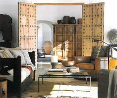 The use of wood here is very textural. Masculine space, but the neutrals help to centre and create a feminine touch.