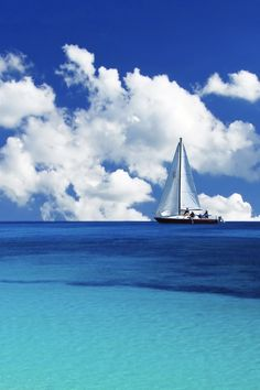 Sailing ship on a very blue ocean http://anymeanstoanend.blogspot.com/