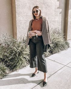 Black wide leg jeans with a rust t-shirt, brown plaid blazer and black slingback flats (black slingbacks, black flats). Quay Australia Jezabell sunglasses, gold chain necklace, gold hoops for simple accessories. Summer to fall outfit, winter to spring outfit, minimal style.