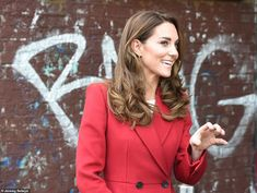 The Duchess wowed in a crimson coat during the visit to Waterloo station this morning to v...