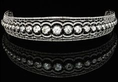 Count Scheel-Plessen's Tiara - central graduated line of circular-cut diamonds in cut-down collets encased within a scalloped millegrain-set frame of circular- and rose-cut stones with a tiara frame & section of diamond links with clasp to form a necklace. The central diamond rivière commissioned by Scheel-Plessen either circa 1882 (for his marriage to Louise) or in 1896, when his Danish title of greve (count) was recognized by Prussia.  Case by Gebr. Friedlander Hof - Juweliere, Berlin W.