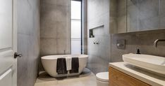 The key ingredients to a cost-effective bathroom renovation Large Bathrooms, Dream Bathrooms, Kitchen Contractors, Walk In Bath, Rustic Toilets, Solid Brick, Remodeling Companies, Standing Bath, Concrete Slab