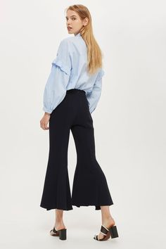 Forget about skinny fit, this season it's all about the 'extreme flare'. These cropped flared trousers come in a flattering high waist and deep navy hue. Wear with an embroidered shirt and mules to create a directional look for work.