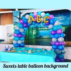 A sweet table balloon arch with ABC written on it in balloon letters.