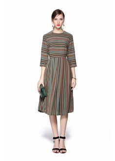 This striped modest dress is great for day to night wear. It features 3/4 length sleeves and a pleated skirt. It is also fully lined (except for the sleeves).