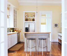Modern Touch: Customized Modern Look- The new base cabinets, island, baker's table, and plate rack were built out of inexpensive paint-grade pine. The island gets a country-cottage touch from cheap beaded-board plywood.