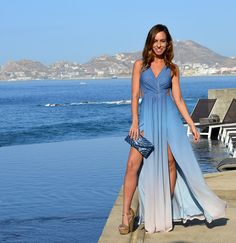 Sydne Style wears blue ombre maxi dress at the cape hotel in cabo mexico
