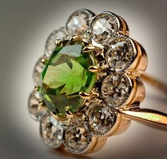 Russian Demantoid Diamond Cluster Ring | From a unique collection of vintage cluster rings at http://www.1stdibs.com/jewelry/rings/cluster-rings/