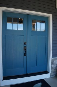 I really like the double doors for the entry but I would add transom windows above and on the sides.