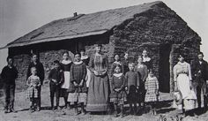 Sod school house in Dry Valley 1887-1888, teacher Eva Campbell and students.