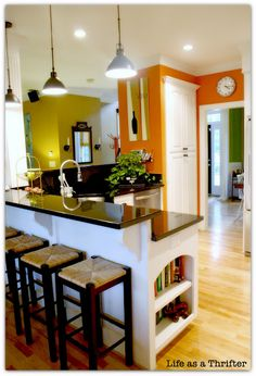 This orange is the color we just painted the kitchen..maybe that dark green in the back for the living room?