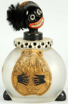 Very cool French Golliwog perfume bottle at Morphy Auctions.