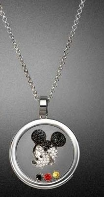 Birthday Gift from the babies and Luke, August 2013. A rose gold and white Gold Mickey Mouse pendant one of each. This one is a Chopard Happy Mickey pendant in white gold with a mobile white and black diamond and ruby.