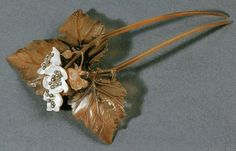 """Lucien Gaillard hair comb """"Aubépines,"""" small white flowers on a hawthorn tree. The comb is horn. The white flowers are mother of pearl with diamonds. Gold drops are sprinkled on the horn to portray the leaves just after rain. 