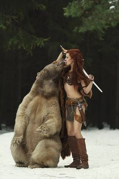 "If that girl didn't look as ""savage"" as she looks, I would say that this is a perfect pic of Lia and a bear"