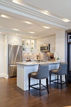 Condo Kitchen Design Ideas Contemporary condo kitchen: subway tiles plus legs on bar. love! | condos