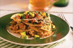 Let your lasagna go Mexican by layering ground beef and sausage with corn tortillas, tomatoes, green chiles, enchilada sauce, and cheese. It's a convenient weeknight dinner that the kids will love as much as the grownups.  Recipe:Mexican Lasagna