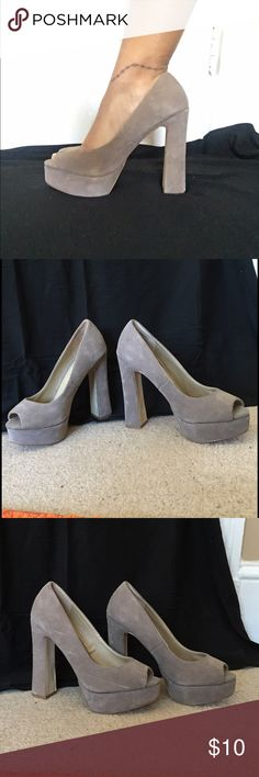Platform Heels Tan color. Never before worn. Sized and listed when bought as a 10, but fit as an 8. 3 slight scrapes to outside of right shoe as seen in picture. Breckelles Shoes Platforms