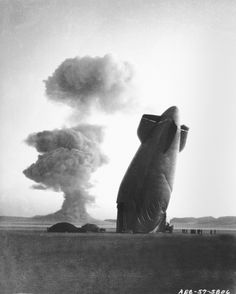 A dirigible falls from the air near an atomic bomb test site in Nevada, due to the shock wave in the air. U.S. Department of Energy Photograph. Public domain.